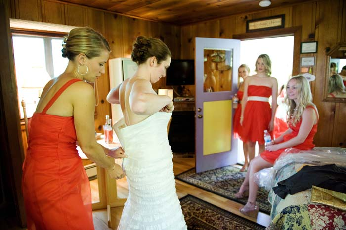 bride putting on her dress in cottage at healdsburg country gardens