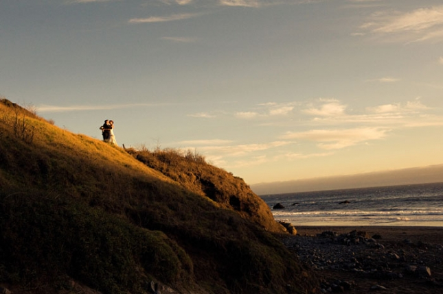 bride and groom on the cliff at muir beach